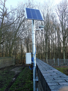 Solar powered camera on railway bridge